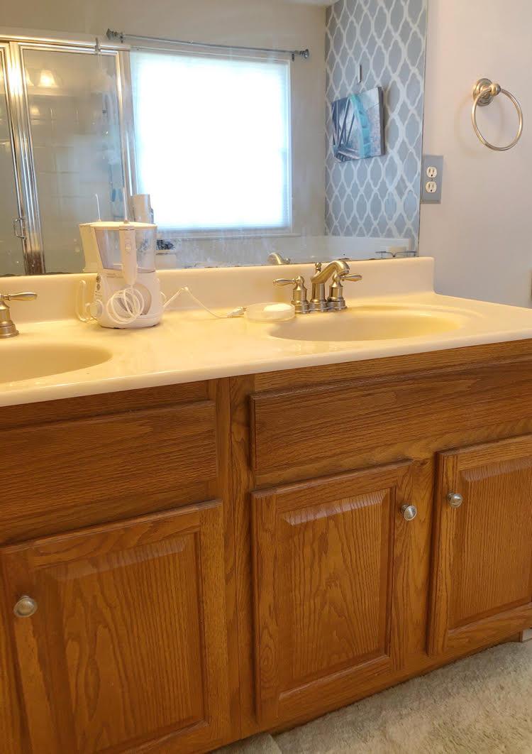 oak bathroom vanity with unframed bathroom mirror