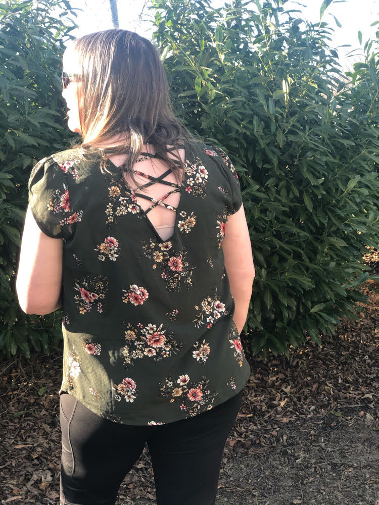 green floral top with an open spaghetti back