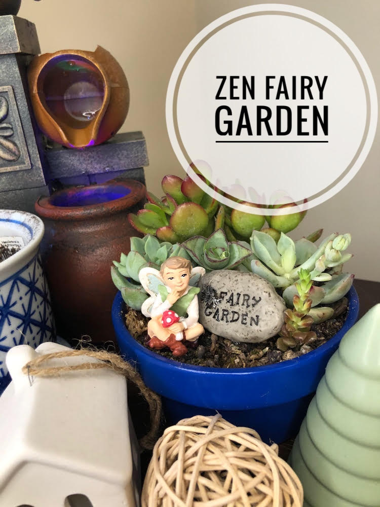 a zen fairy garden with succulents, fairy figuring and tabletop fountain