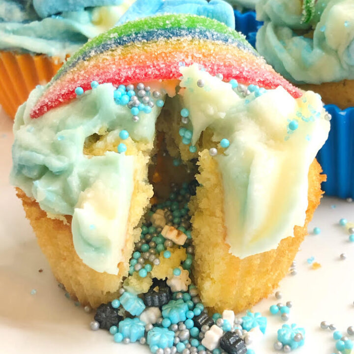 cupcake iced with buttercream icing and filled with sprinkles