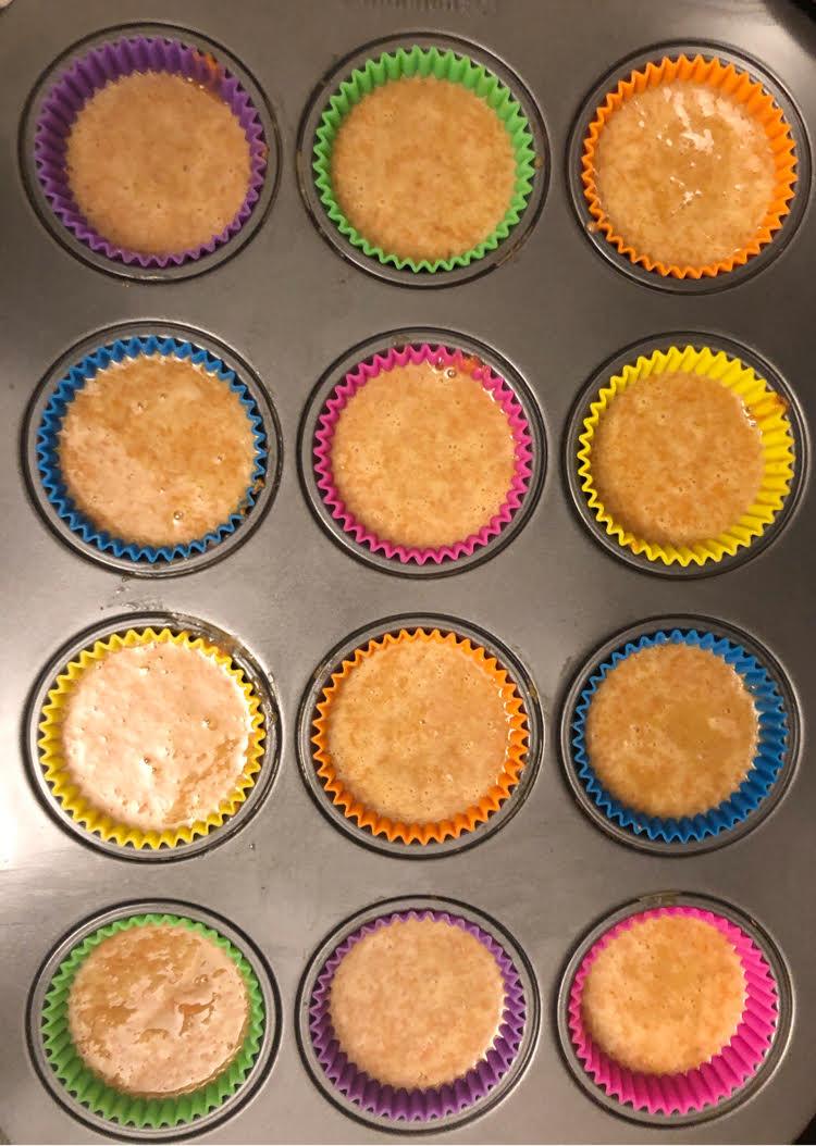carrot cupcake batter in silicone cupcake liners in nonstick cupcake pan