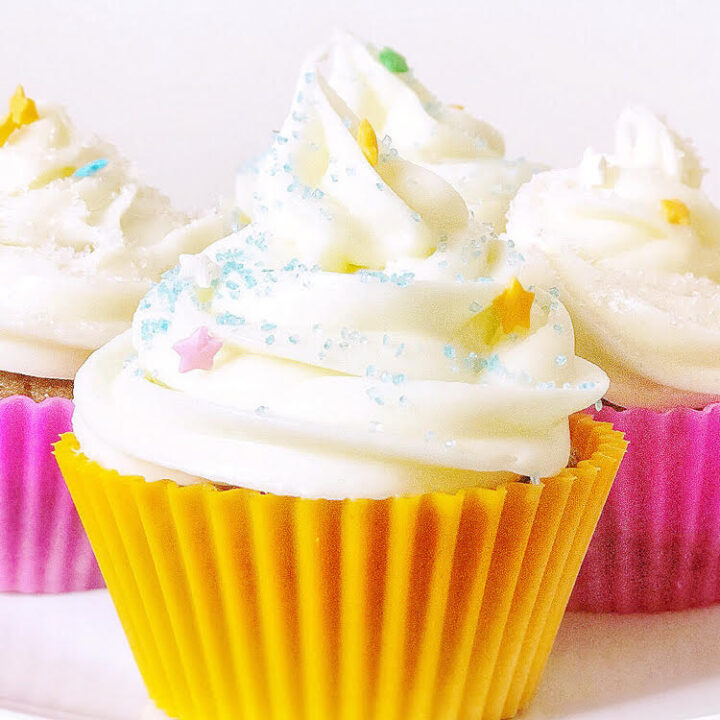 carrot cupcakes with cream cheese icing in pretty silicone reusable cupcake liners