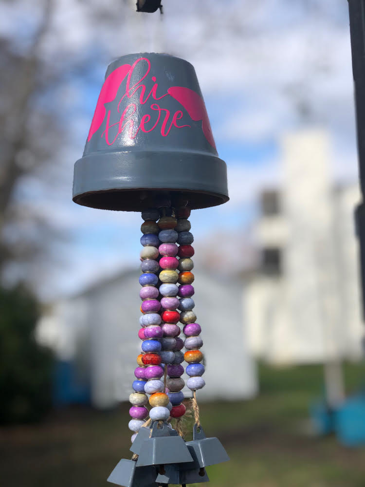 wind chimes made with a terra cotta pot and strings of beads