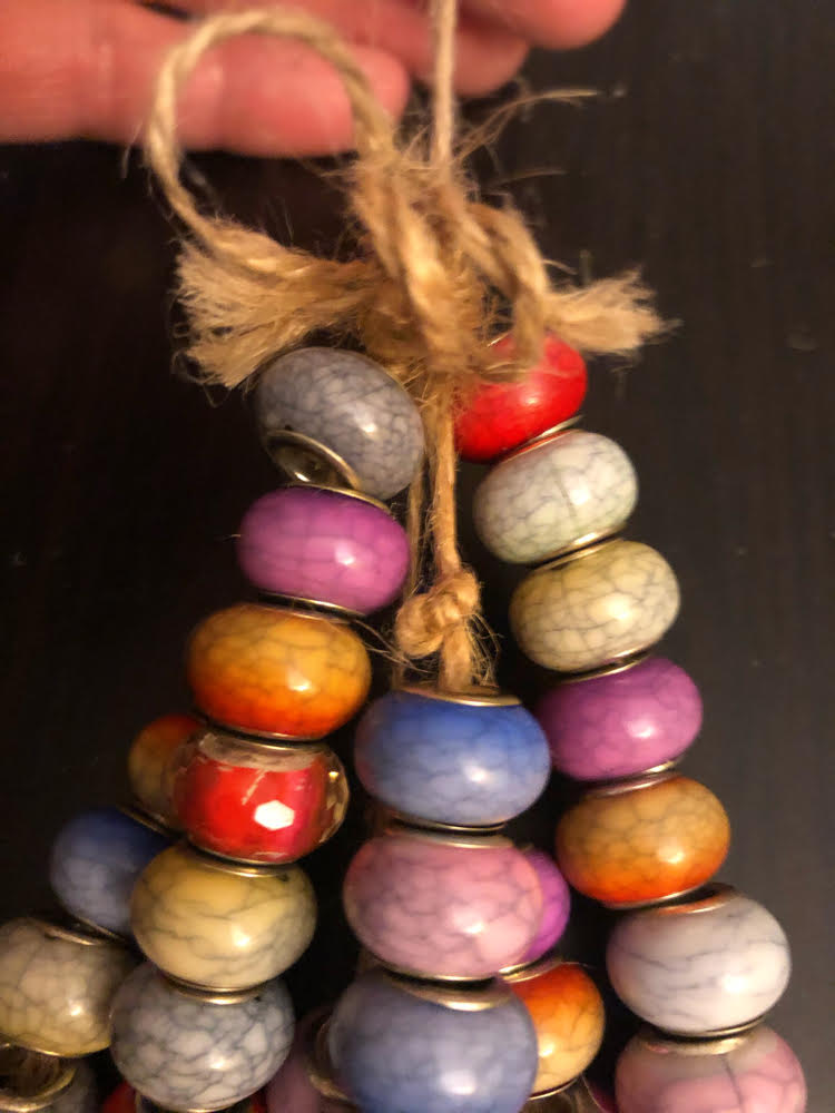 knotted lengths of acrylic beads for a DIY wind chimes craft