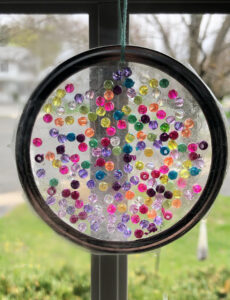 suncatcher craft with mason jar ring, iridescent beads and duck tape