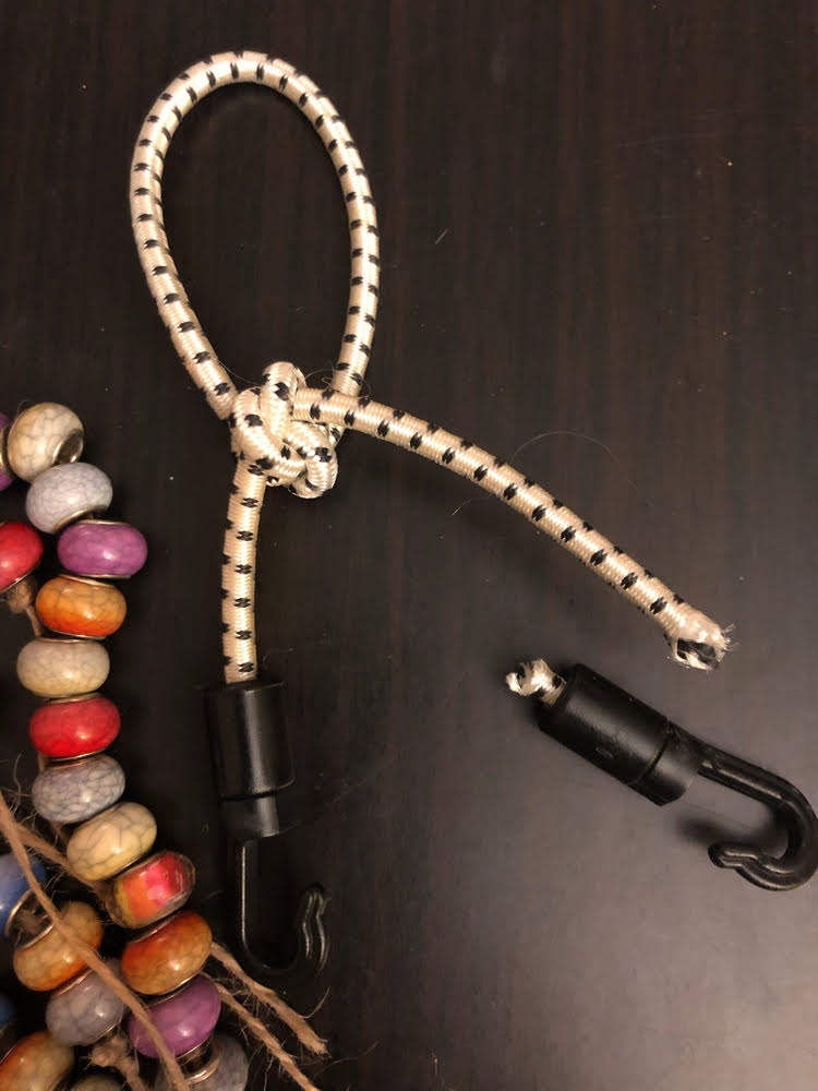 knotted bungee cord and strings of beads for DIY wind chimes craft