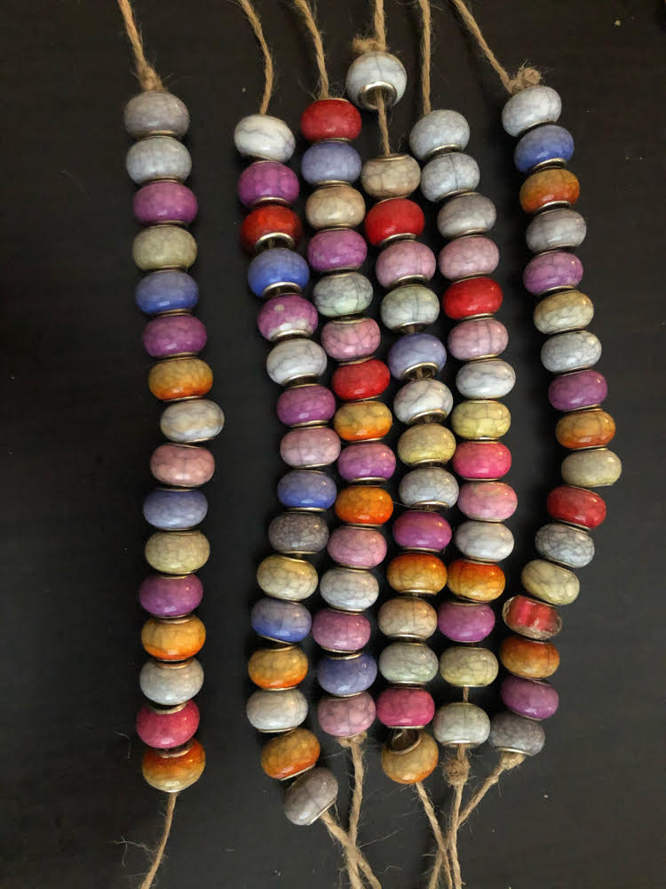 string acrylic beads on twine for a wind chimes craft