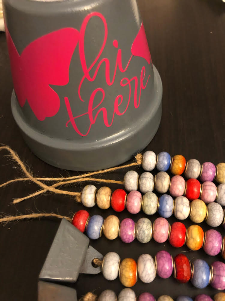 Vinyl decorated and spray painted terra cotta pot with acrylic beads for wind chimes craft