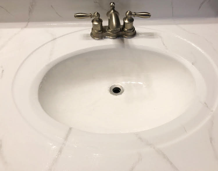 Countertop that looks like new after being painted with a Giani marble countertop kit