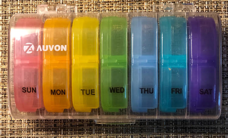 large daily pill organizer with separate daily pill containers with day and night sections