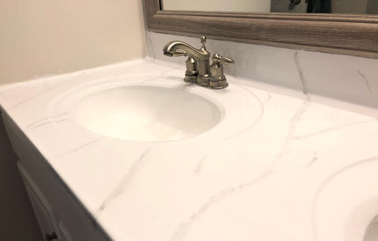 a bathroom counter painted with a Giani marble countertop kit