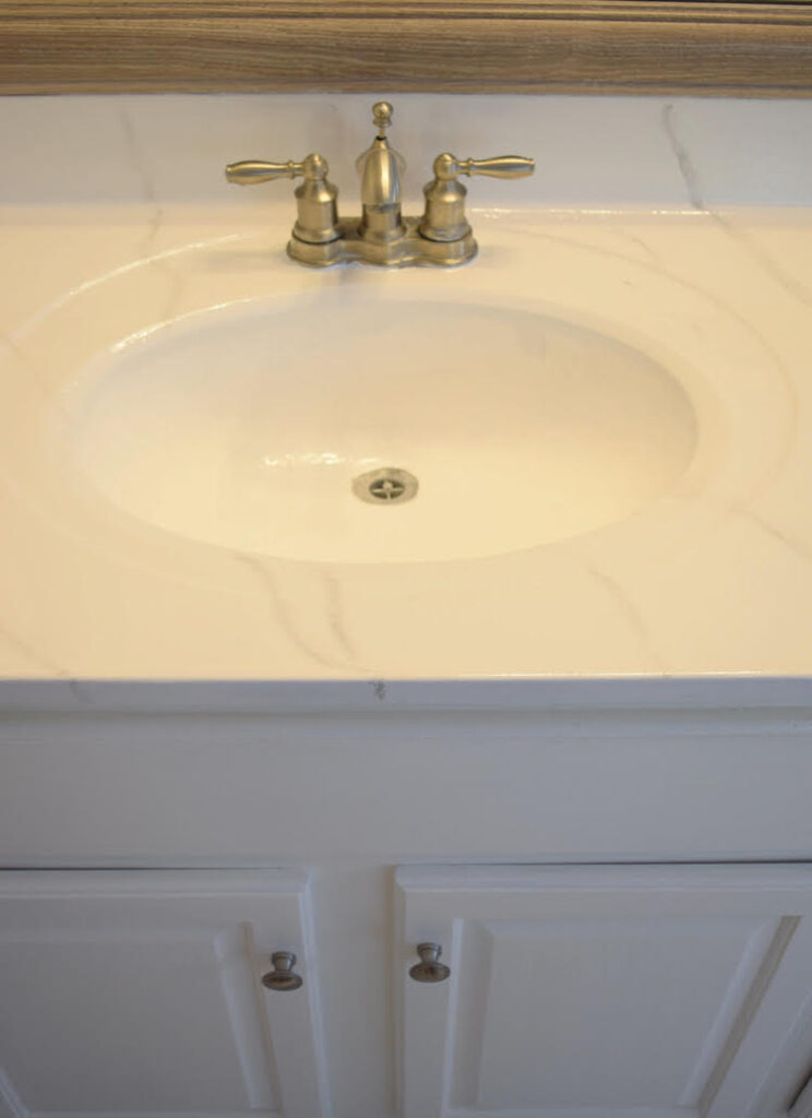 a cultured marble vanity updated with a Giani marble countertop kit and Ekopel sink and tub refinishing coating