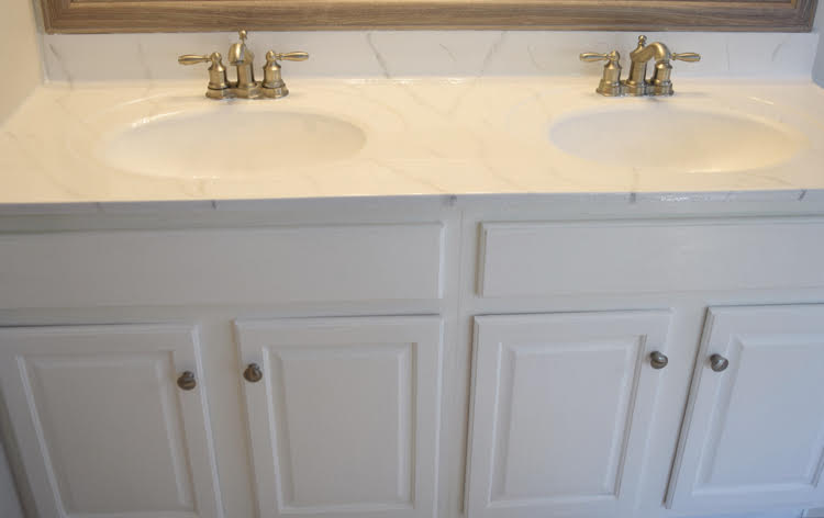 painted white vanity with diy marble epoxy counters