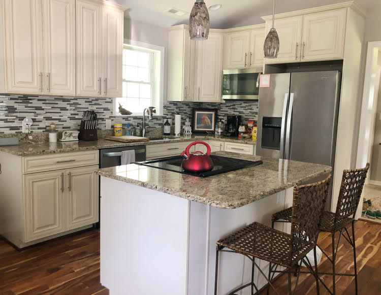 modern kitchen with granite counters and off white cabinets in Annapolis 2 bedroom Airbnb