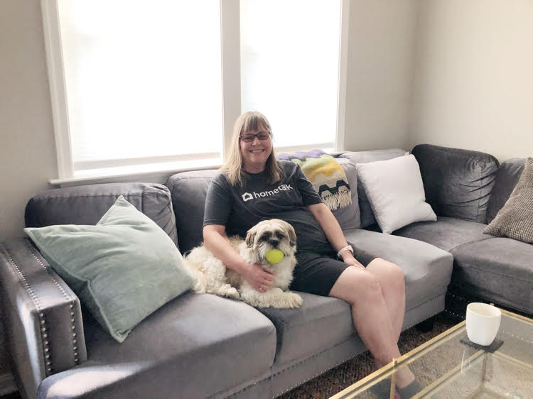 Lauren of Mom Home Guide enjoys the comfy sectional in the Annapolis Airbnb she rented with her family and puppy