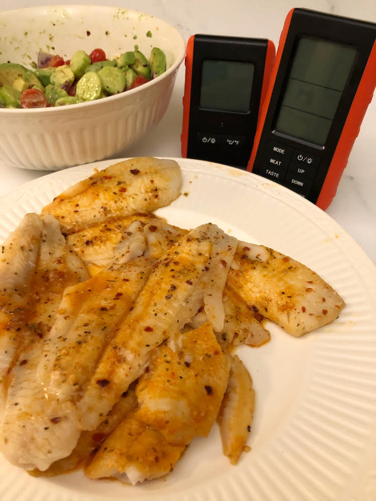 grilled fish, avocado salad, remote thermometer transmitter and receiver