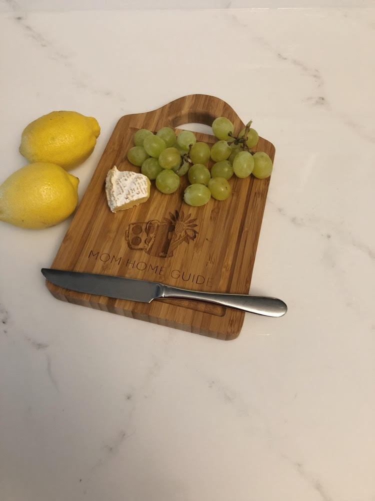 lemons, plus cutting board with brie and grapes on a cutting board