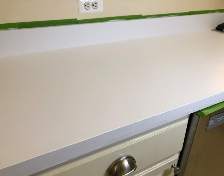 primed kitchen counters ready for Giani painted marble veining