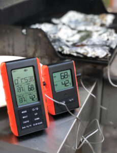 remote grill thermometer set to fish for cooking on the grill
