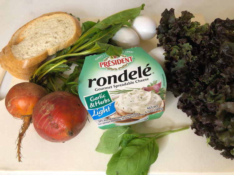 Rondele spreadable cheese, beets, sour dough bread, basil, hardboiled eggs and lettuce