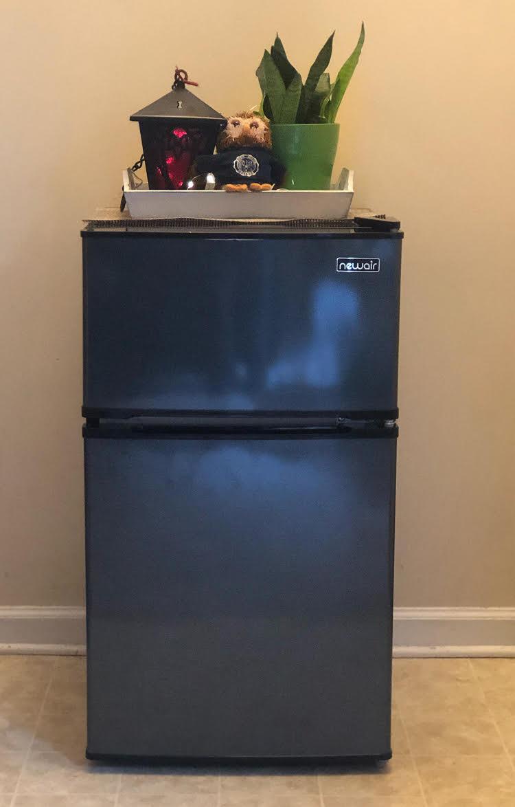 black stainless NewAir mini refrigerator