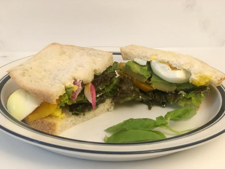 roasted beets, avocado, hardboiled egg, pickled onion, lettuce and basil on sourdough bread