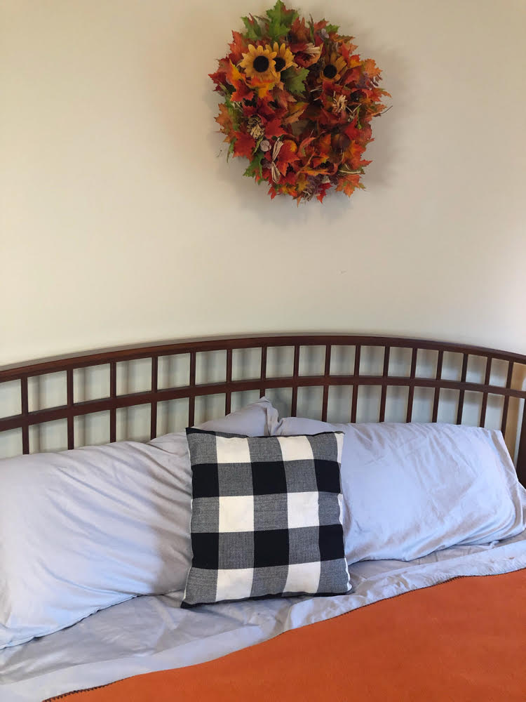 I love this cozy orange, black and gray Autumn bedroom