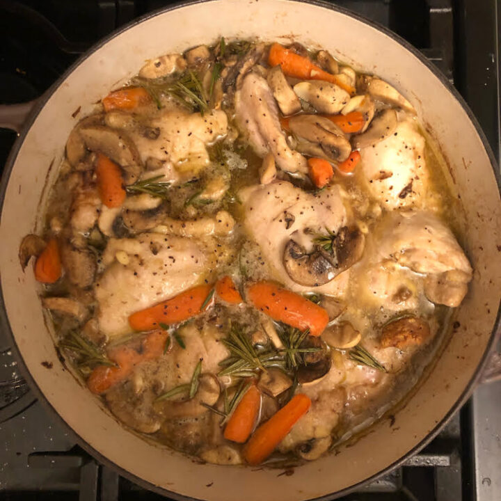 chicken braised in beer with mushrooms, carrots and thyme