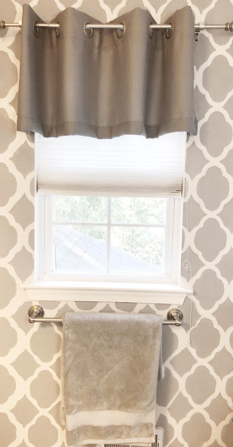Luxury gray Therapedic bath sheet against a gray stenciled bathroom feature wall