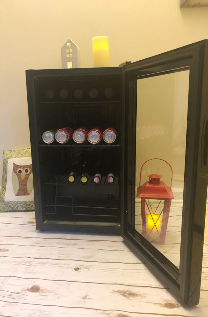 The NewAir 20th Anniversary Limited Edition Beverage Fridge has a dual pane glass door, enough room for 100 cans, and can cool drinks to 37 degrees.